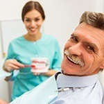 Male All-on-4 dental implant patient smiling