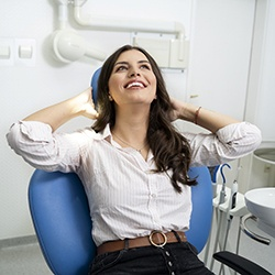 Woman smiles while visiting Grapevine sedation dentist