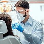 Dentist conducting dental exam
