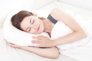 woman resting peacefully on pillow