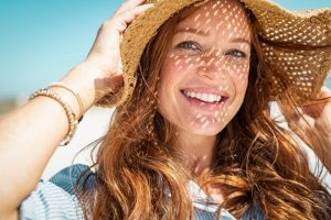 Smiling woman in summer hat